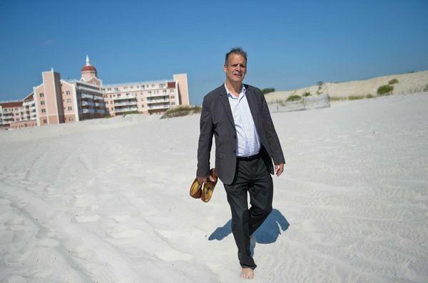 Resident Alan Graboyes walks on the beach outside
