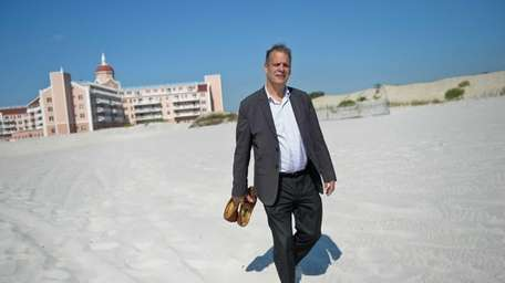 Resident Alan Graboyes walks on the beach outside