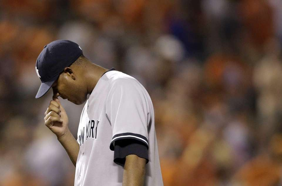 Yankees starting pitcher Ivan Nova pauses after Baltimore
