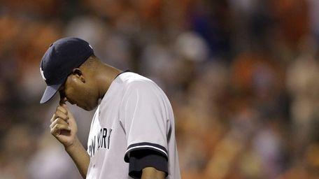 Yankees starting pitcher Ivan Nova pauses after Baltimore