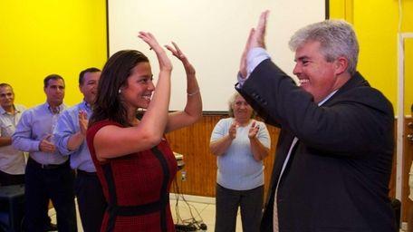 Monica Martinez celebrates her victory in the primary