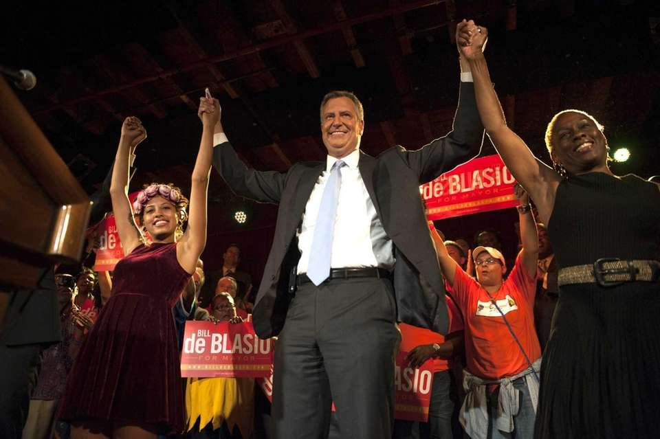 Democratic mayoral candidate Bill de Blasio celebrates with