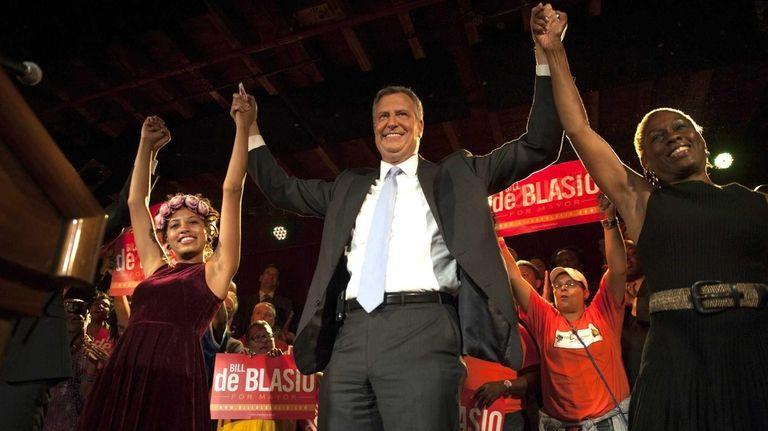 Democratic mayoral candidate Bill de Blasio celebrates with