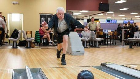 John G. Schreiber, 79, of Smithtown, bowls with