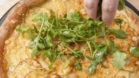 Potato pizza with Fontina and arugula is a