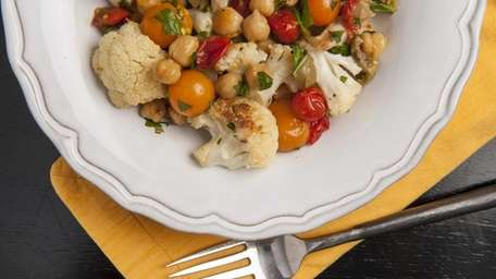Roasted cauliflower and cherry tomatoes with chickpeas and