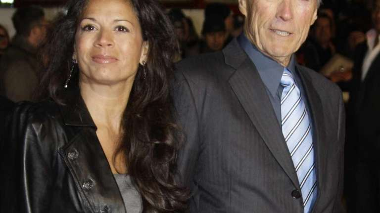 Clint Eastwood arrives with his wife, Dina on