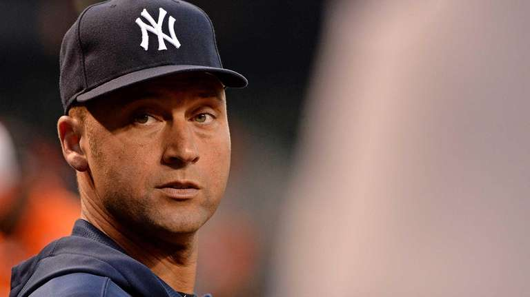 Derek Jeter looks on from the dugout during