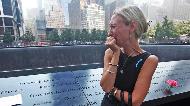 Carrie Bergonia of Pennsylvania looks over the name