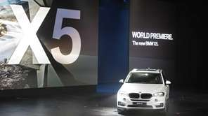 The BMW X5 rolls onto the stage during