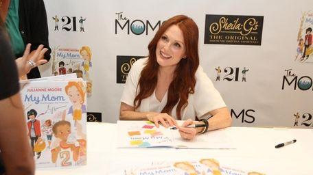 Julianne Moore signs copies of her new book,