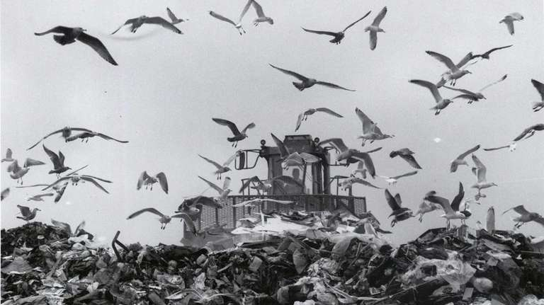 A payloader pushes garbage at the Islip landfill