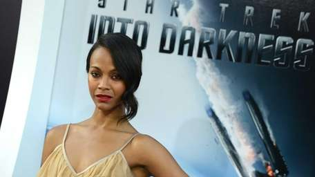 Zoe Saldana arrives at the premiere of