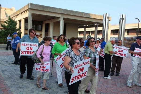 Adjunct Faculty Association members picket outside the Administrative