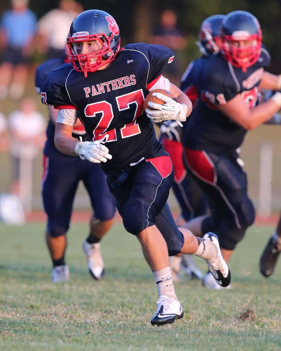 Miller Place running back Jake Buonaiuto breaks through
