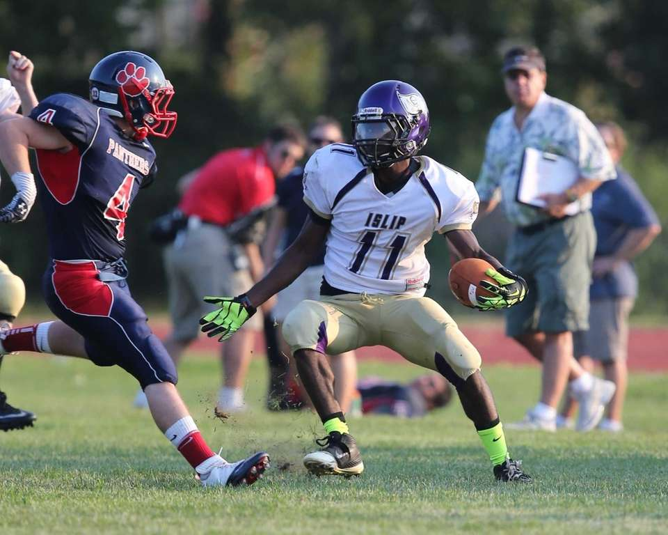 Islip's Wynell Michaud makes yardage on a kickoff