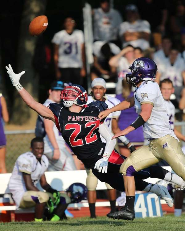 Miller Place receiver Austin Yezarski dives for a