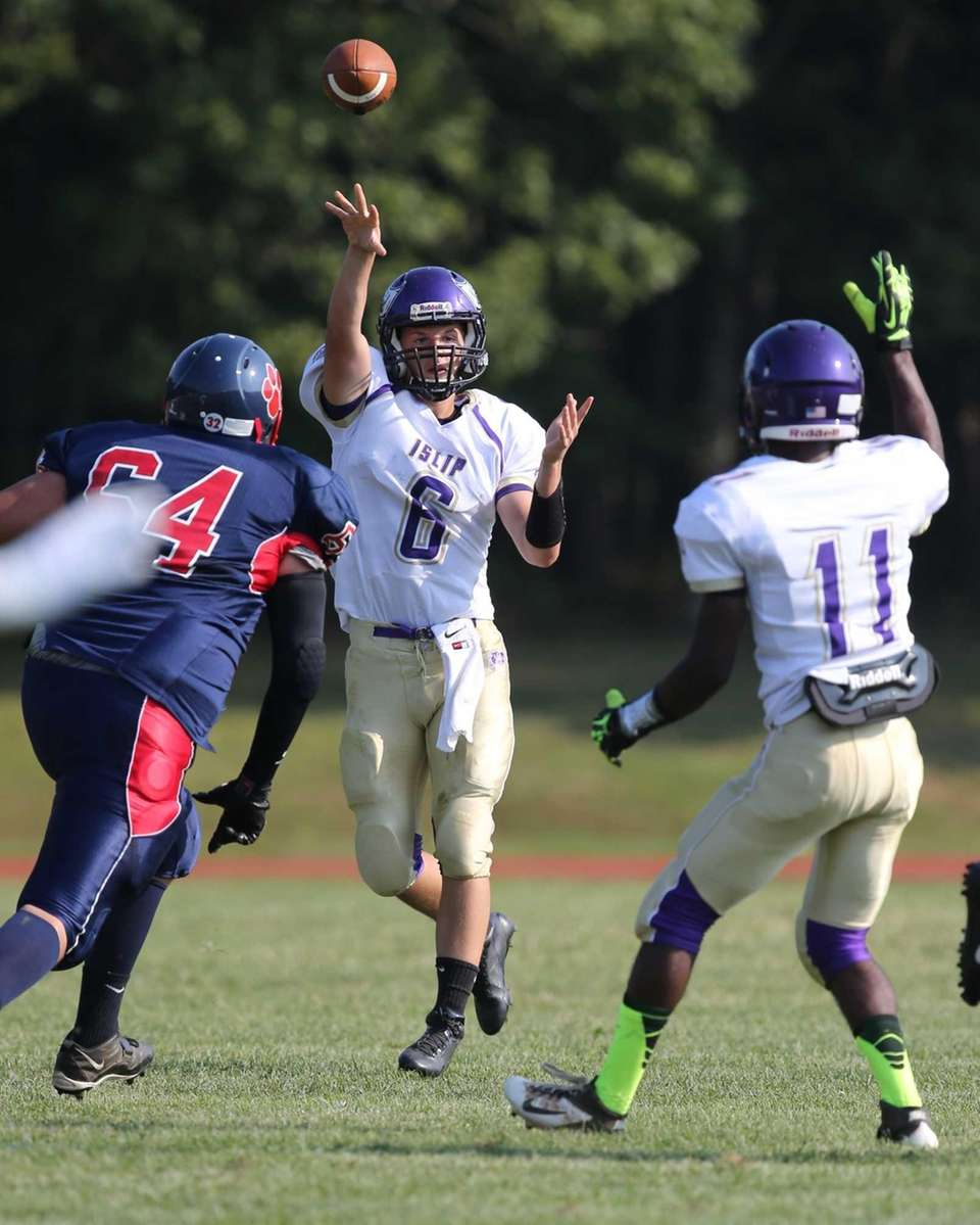 Islip quarterback Kieran Mullins throws a screen pass