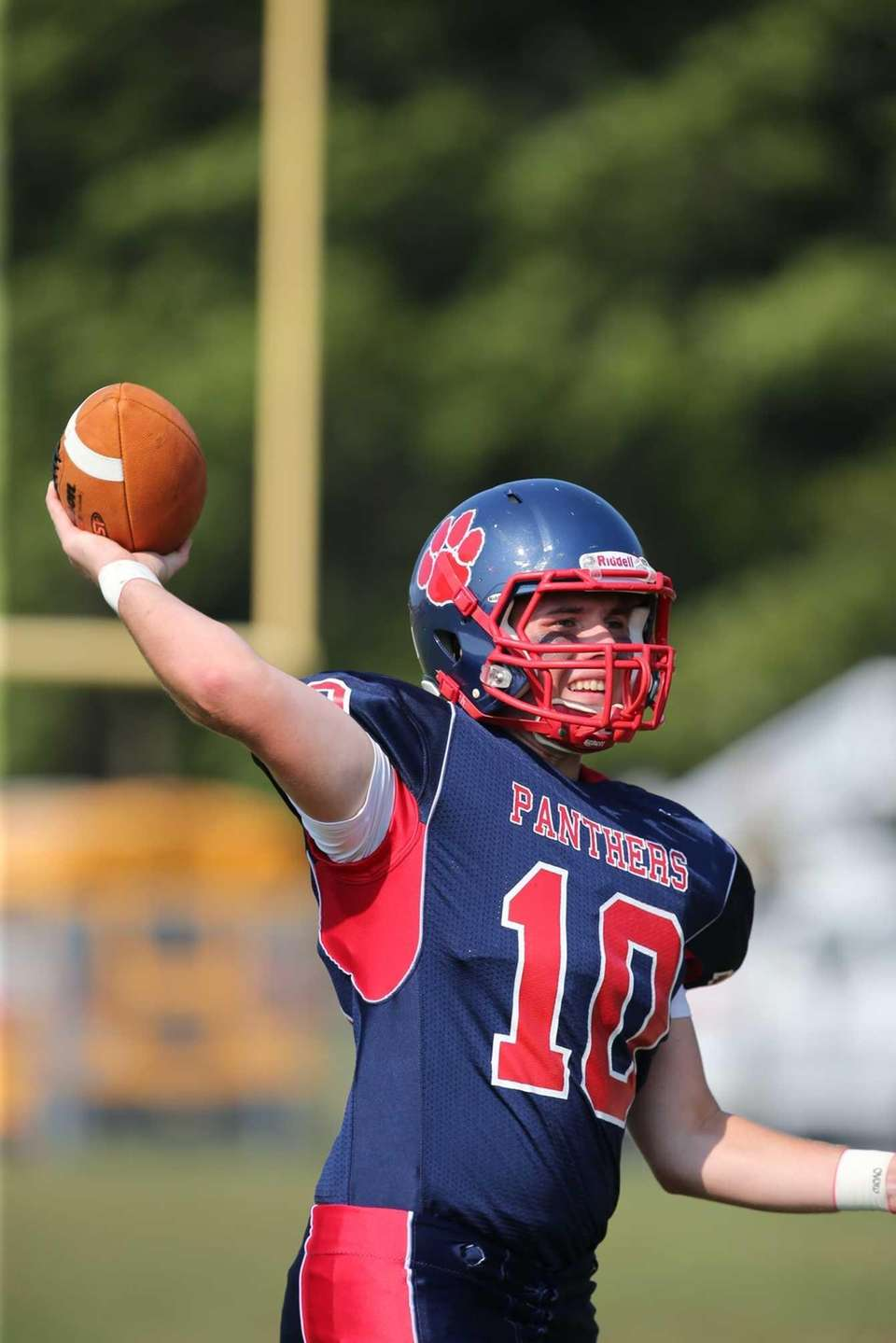 Miller Place quarterback Liam Walsh warms up before