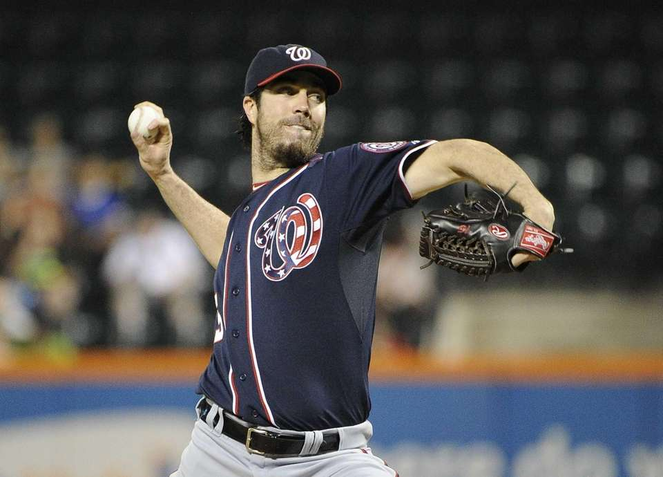 Washington Nationals starting pitcher Dan Haren delivers a