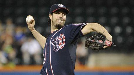 Washington Nationals starting pitcher Dan Haren delivers a