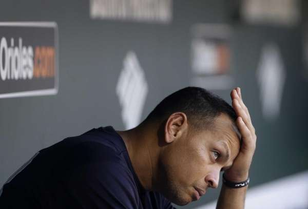 Alex Rodriguez wipes sweat from his brow as