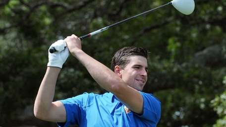John Tavares takes a practice swing before teeing