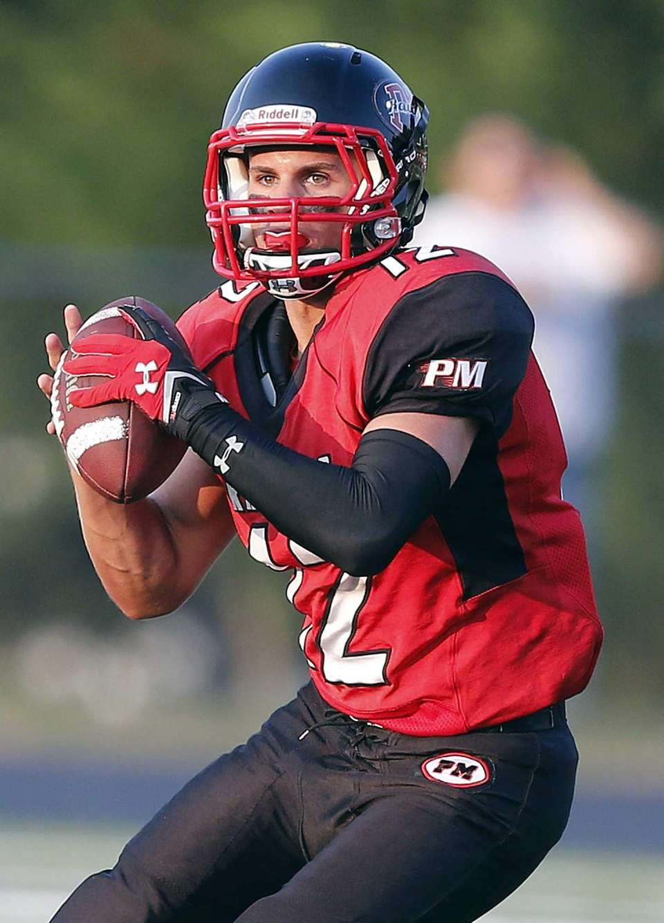 Patchogue quarterback Anthony Lee steps into pocket to