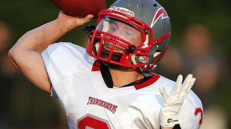Connetquot quarterback Michael Grimaldi passes from the pocket