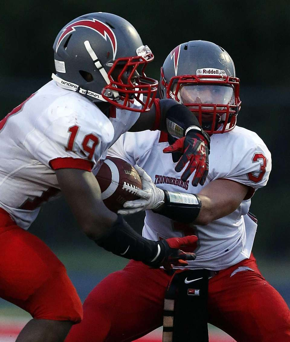 Connetquot quarterback MIchael Grimaldi hands off in the