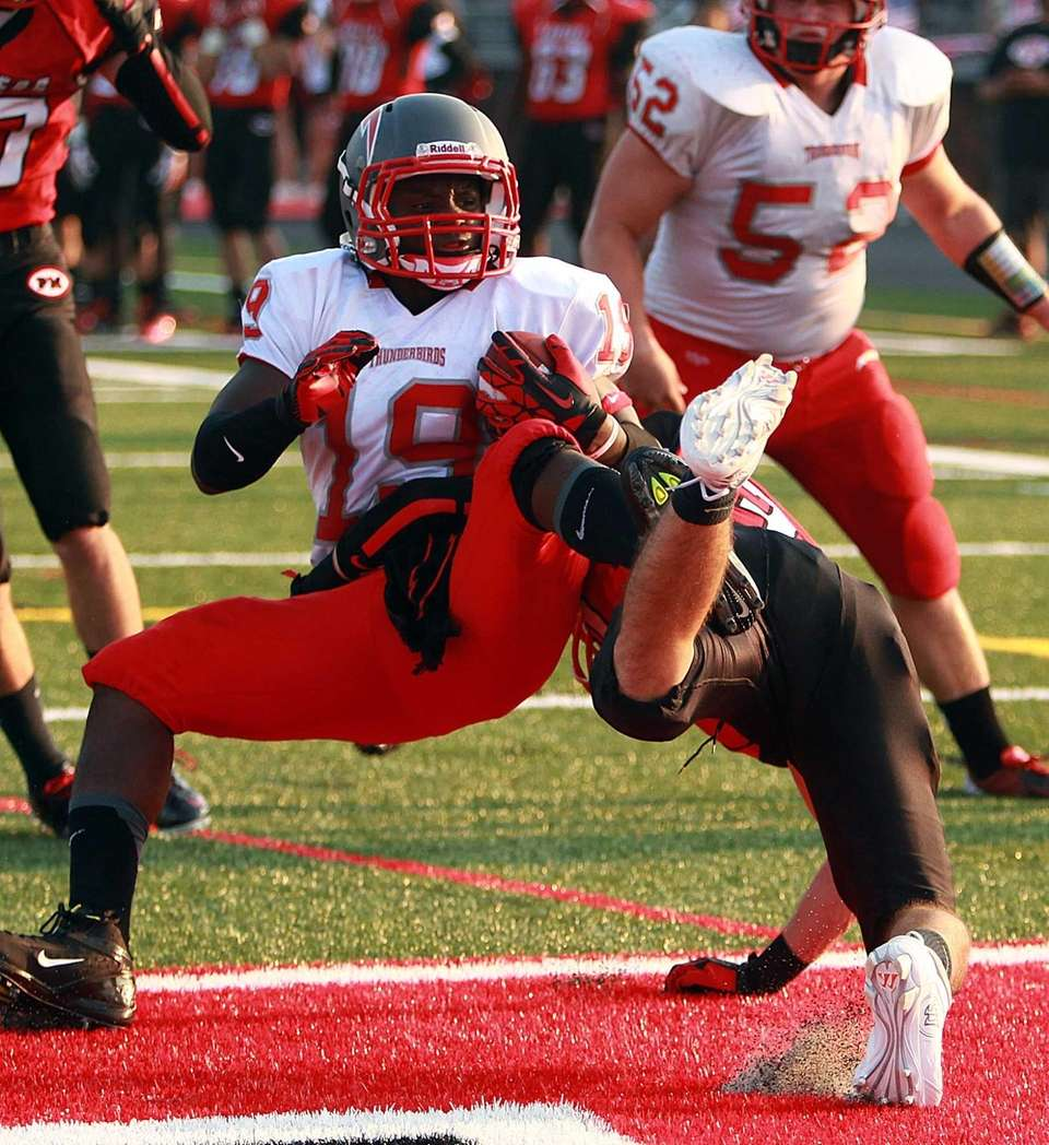 Connetquot's Marcus Gutierrez spins into the end zone