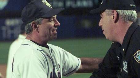 Then-Mets manager Bobby Valentine shakes hands with a