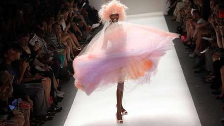 All the models wore finger-in-the-light-socket pink party wigs