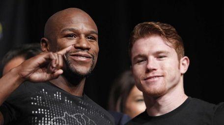 Boxers Floyd Mayweather, left, and Canelo Alvarez pose