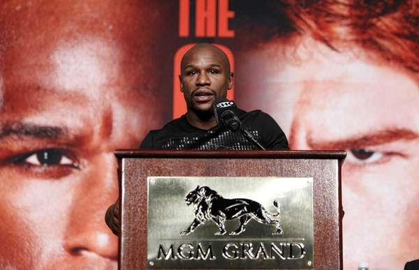 Boxer Floyd Mayweather speaks during a press conference