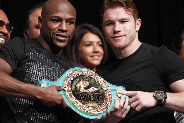 Boxers Floyd Mayweather, left, and Canelo Alvarez pose