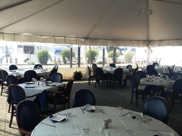 In Merrick, AcQua's outdoor dining tent offers water
