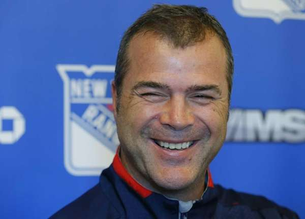 Alain Vigneault speaks to the media during Rangers