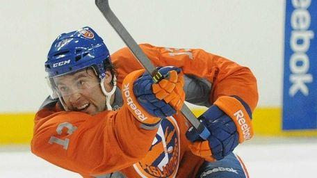 Islanders right wing Colin McDonald follows through on
