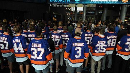 Members of the New York Islanders organization gather