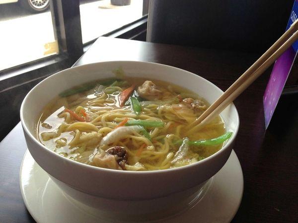 A big bowl of wonton noodle soup at