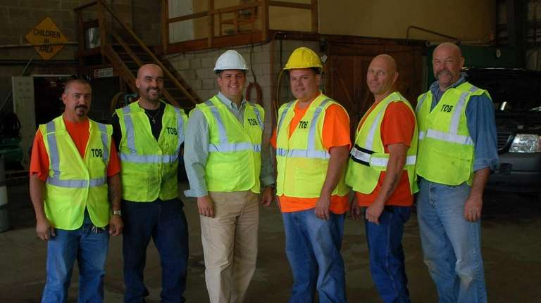 Brookhaven highway workers' new bright, lime-green vests and