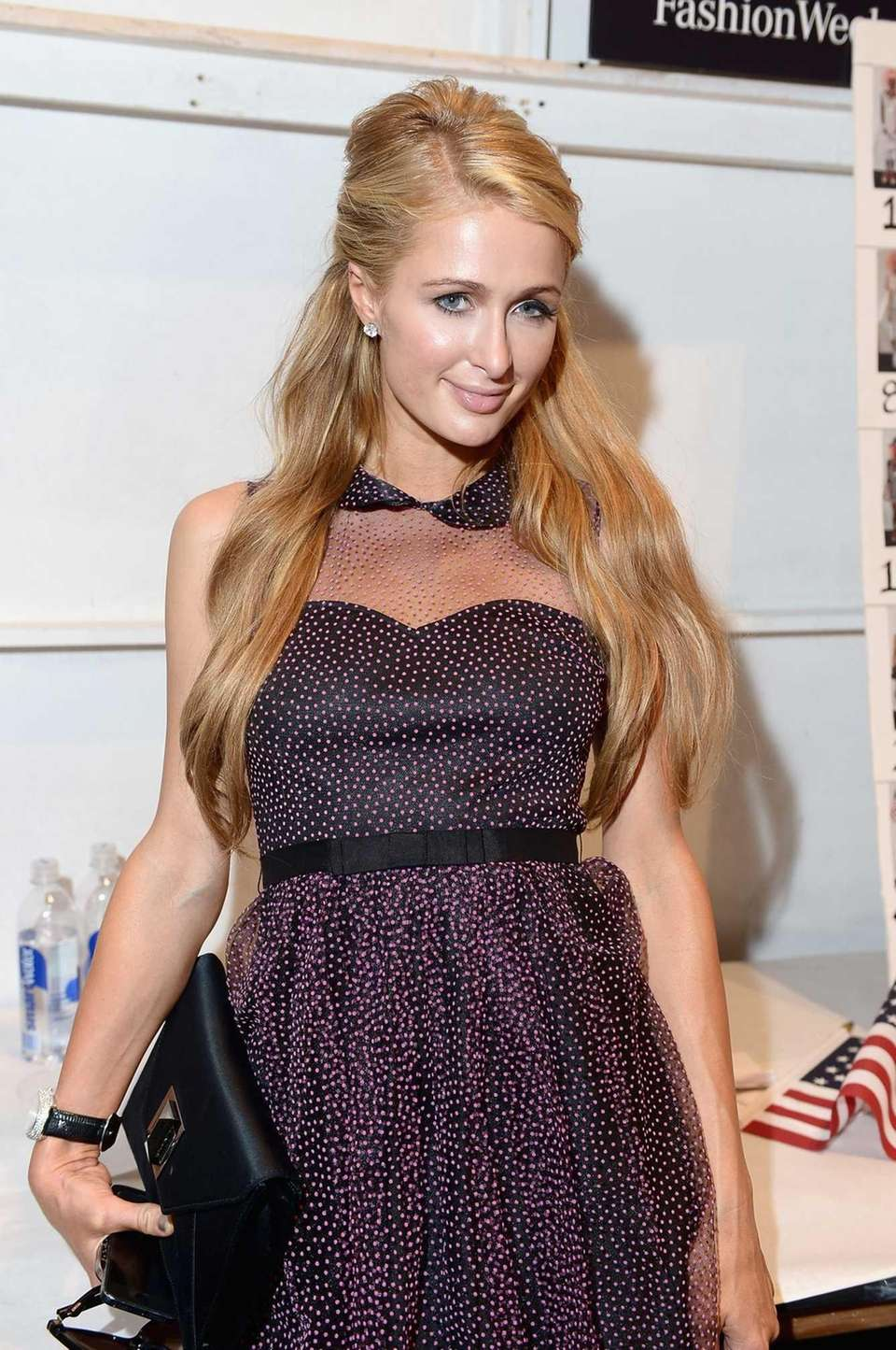 Paris Hilton poses backstage at the Betsey Johnson