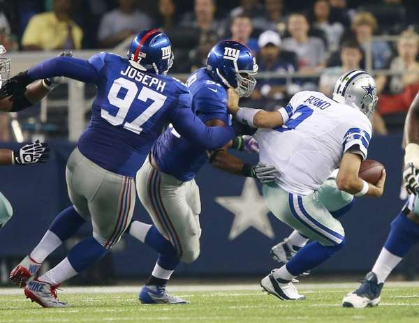 Dallas Cowboys quarterback Tony Romo (9) is sacked