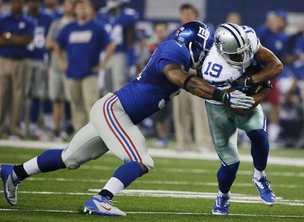 Dallas Cowboys wide receiver Miles Austin is tackled