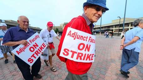 Adjunct Faculty Association members, on strike, picket outside