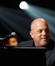 Billy Joel performs at the 12-12-12 concert at