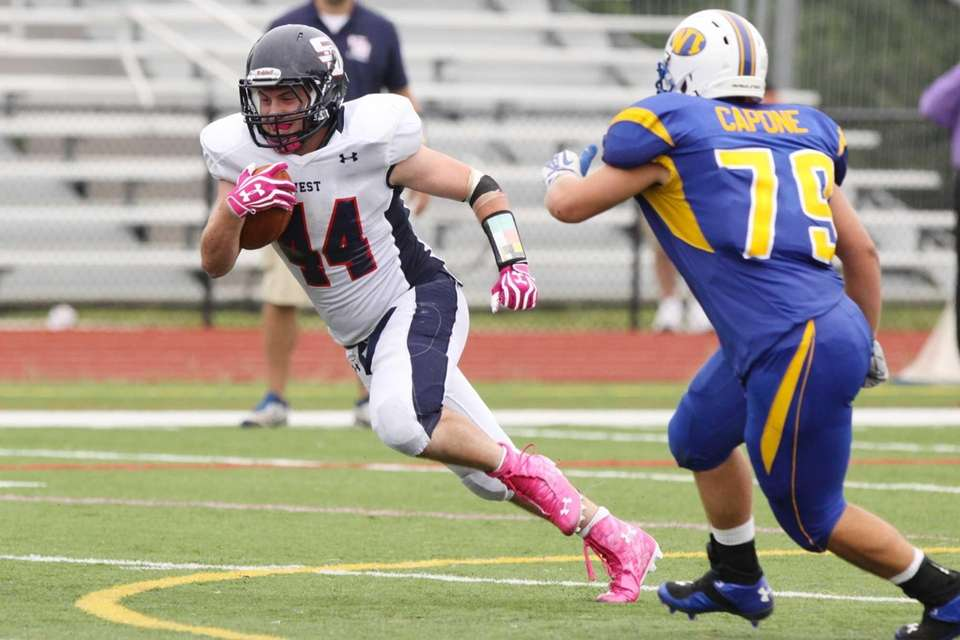 Smithtown West's Logan Greco, left, eludes West Islip's
