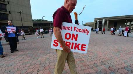 Striking Adjunct Faculty Association members picket outside the