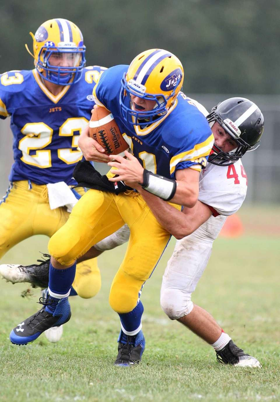 East Meadow quarterback Adam Arbuse tries to break